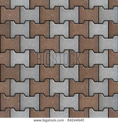 Brown and Gray Pavement Consisting of Geometric Shapes.