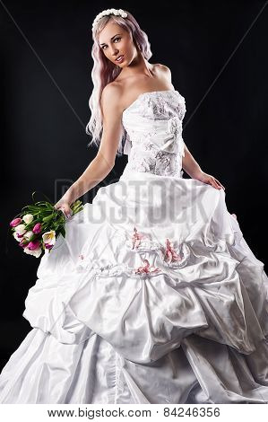 luxurious bride with wedding bouquet of tulips