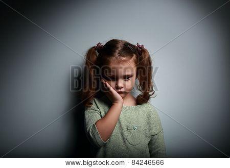 Sad Alone Kid Girl Thinking On Dark Background. Problems At Family.