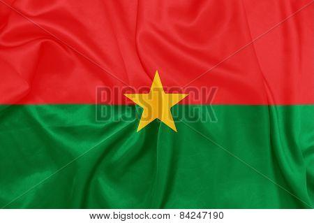 Burkina Faso - Waving national flag on silk texture