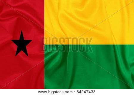 Guinea Bissau - Waving national flag on silk texture