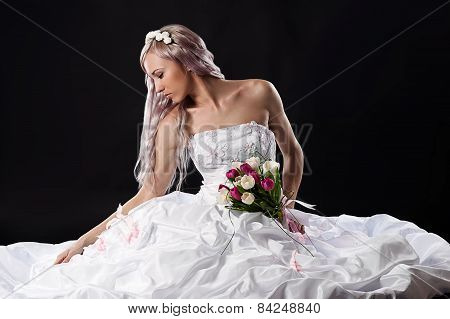 bride sitting on the floor in a wedding dress