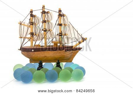 Wooden Toy Ship At Sea Isolated Overwhite