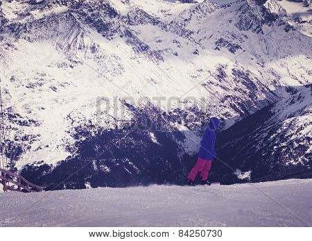 Young Alpine skier skiing downhill