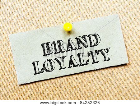 Recycled Paper Note Pinned On Cork Board. Brand Loyalty Message. Concept Image