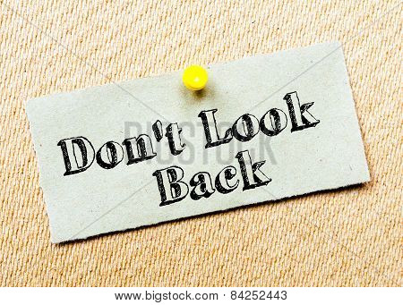 Recycled Paper Note Pinned On Cork Board. Don't Look Back Message. Concept Image