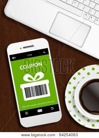 Mobile Phone With Spring Discount Coupon, Laptop And Cup Of Coffee