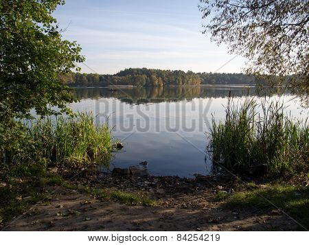 Autumn Scenery Scenic Shore Of The River In Forest With The Middle Of The River Fisherman Fishing On