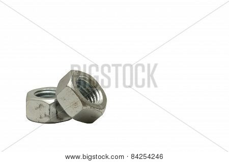 Two Silver Metallic Scratched Nuts Lying One On One On A Clean White Background