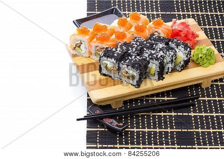 Set Of Japanese Sushi With Chopsticks And Soy Sause Over White With Sample Text