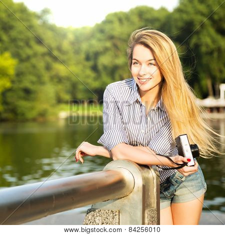 Portrait of Hipster Girl with Photo Camera