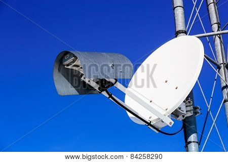 Parabolic Antenna Large White Against The Blue Sky
