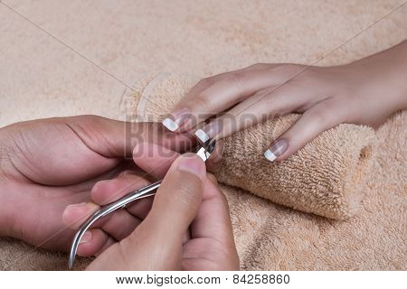 Manicure. Trimming the cuticle