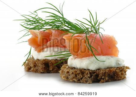 Two  Salmon Canapes With Fresh Dill Garnish, Isolated On White Background