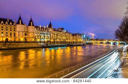 The Conciergerie And The Seine River In Paris - France