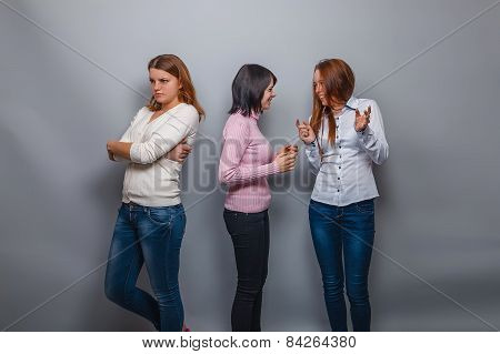 two girls talking European appearance and ignore the third girlf