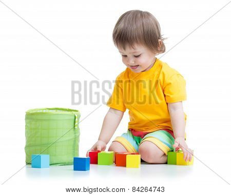 kid boy playing wooden toys