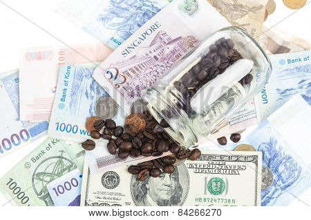 Coffee Bean With Several Kind Of Bank Notes And Coin