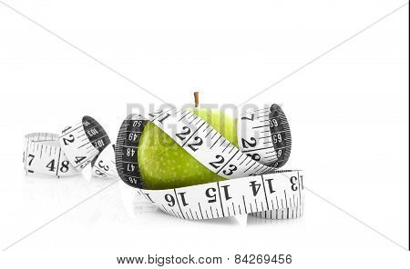Green Apple With Tape Measure On A White Background