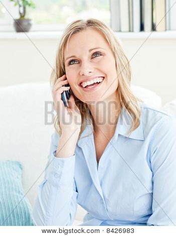 Joyful Businesswoman Talking On Phone Sitting On A Sofa