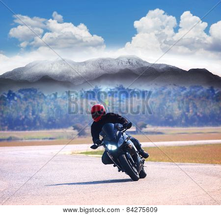 Young Man Riding Motorcycle On Asphalt Road Against Mountain Highways Background Use For People Acti