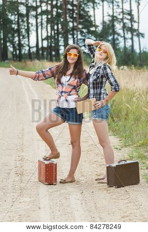 Student Hitchhikers Wearing Sunglasses