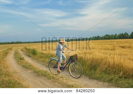 Teenager Boy Rides A Bicycle On Country Road