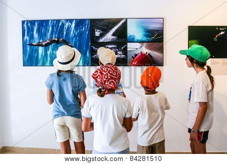 People Watch The Exhibition Of The World Press Photo