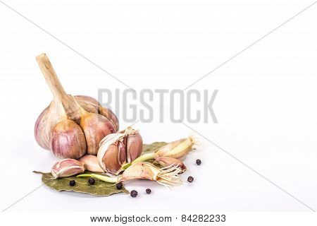clove of garlic and black pepper  still life isolated