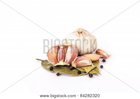 clove of garlic and bay leaves still life isolated