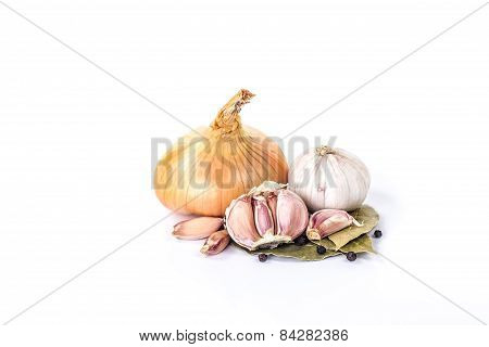 clove of garlic, bulb onion and black pepper isolated