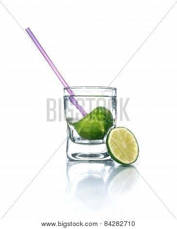 Cold Drink With Lime And Drinking Straw. Glass Beaker With Vodka Over White Background