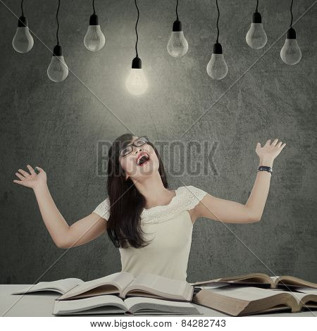 Attractive Student Studying Under Lamp