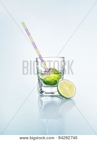 Vodka With Lemon - Lime And Drinking Straw In Glass Beaker
