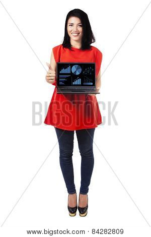 Attractive Woman With Financial Chart On Laptop