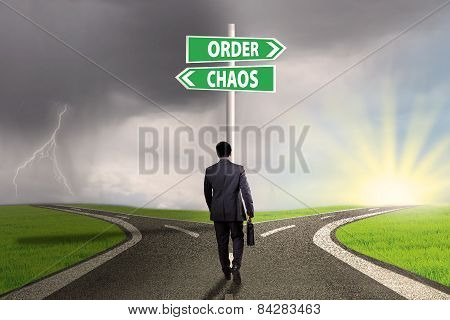 Business Leader With Signpost On The Road