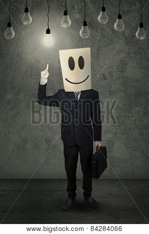 Businessperson Choosing Bright Lamp