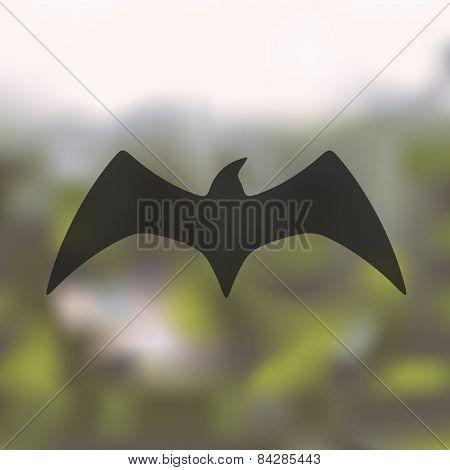 bird icon on blurred background