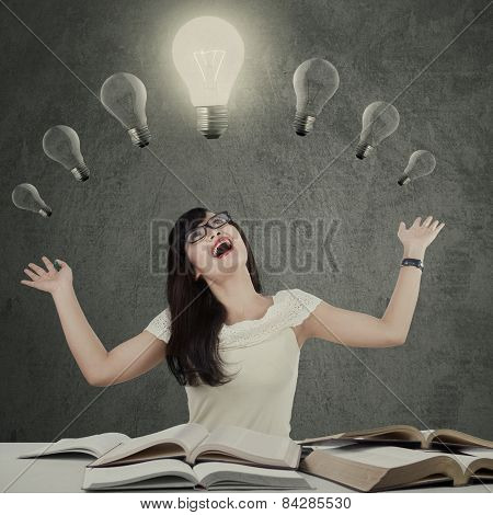 Cheerful Female Student Under Lamp