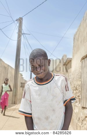 Editorial caption: Thiaroye, Senegal, Africa - July 30, 2014: boy standing in the street