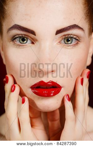 Portrait of beautiful woman with red hair and smoky eyes makeup