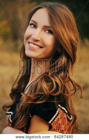 Cute Young Woman In The Autumn Field