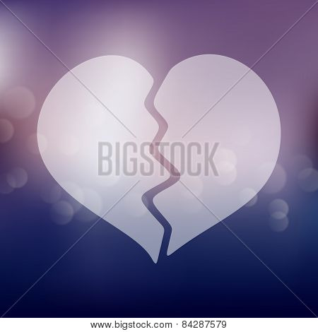 broken heart icon on blurred background