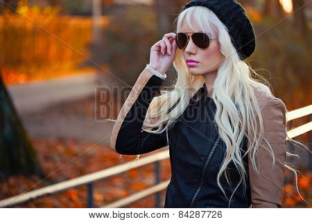 Beautiful Blonde Woman In Sunglasses Outdoors