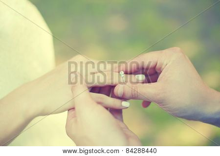 Love, Engagement And Wedding Concept - Female And Male Hands With Ring Closeup