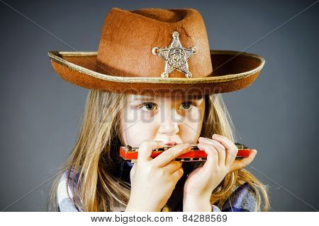 Cute Little Girl Playing Harmonica