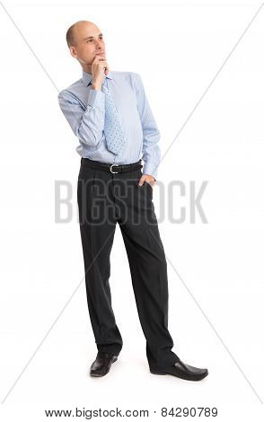 Thoughtful Bald Businessman Looking Up