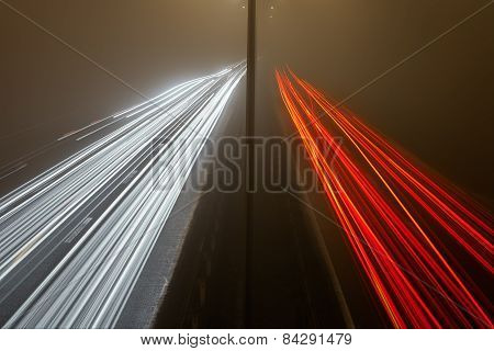Light Trails On The Highway At A Foggy Night