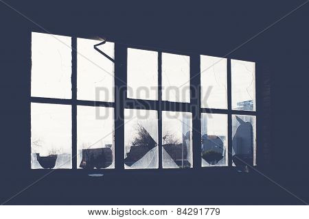 Broken Glass At Window Of Old Industrial Building