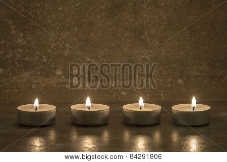 Tea Candles On Concrete